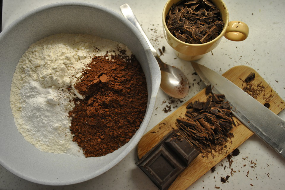 A bowl with carefully measured ingredients for making brownies