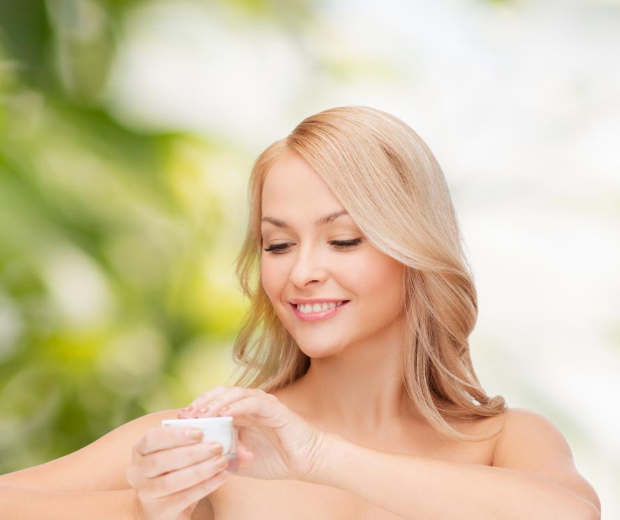 Woman applying CBD beauty cream