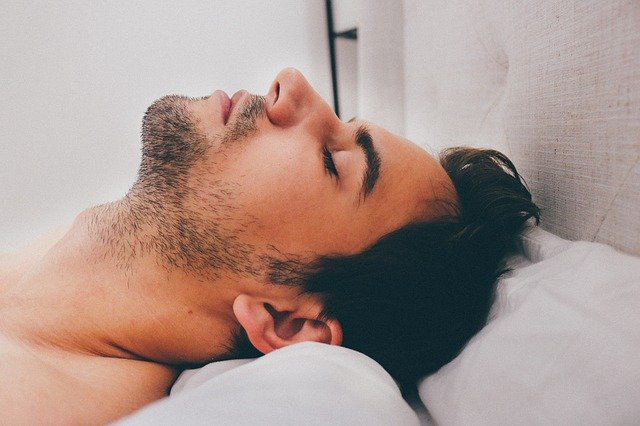 A man sleeping peacefully after taking CBD