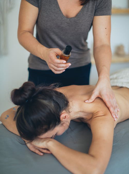 a-woman-undergoing-CBD-infused-massage-therapy