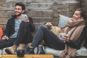 A man and a woman having some CBD-infused coffee